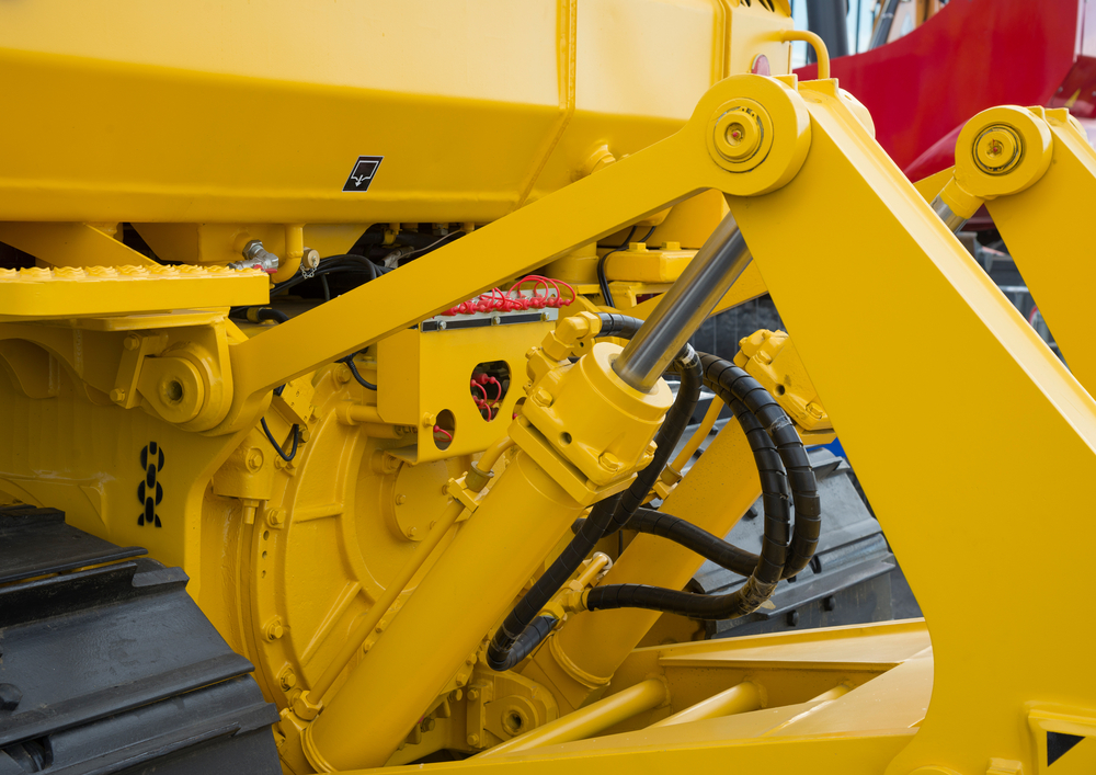 Image of a hydraulic bulldozer piston excavator arm