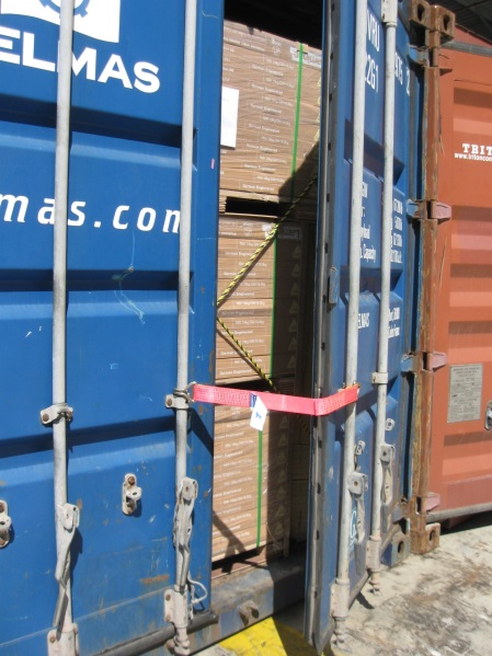 Image of container doors with restraint attached