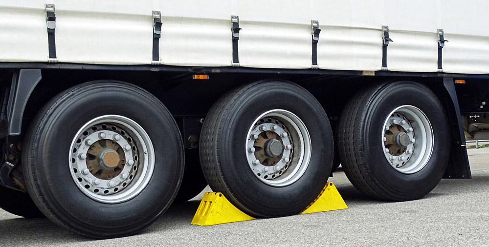 image of chocks being used at the truck wheels