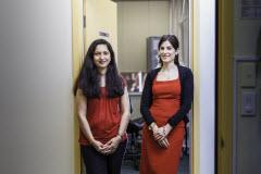 Tow young women smiling in a doorway