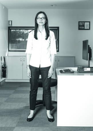 Stand next to your desk, with feet shoulder width apart.