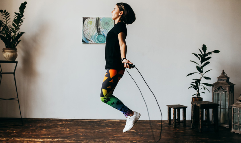 Woman exercising by skipping a rope