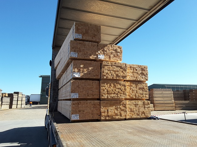 Image of pine timber packs on truck.