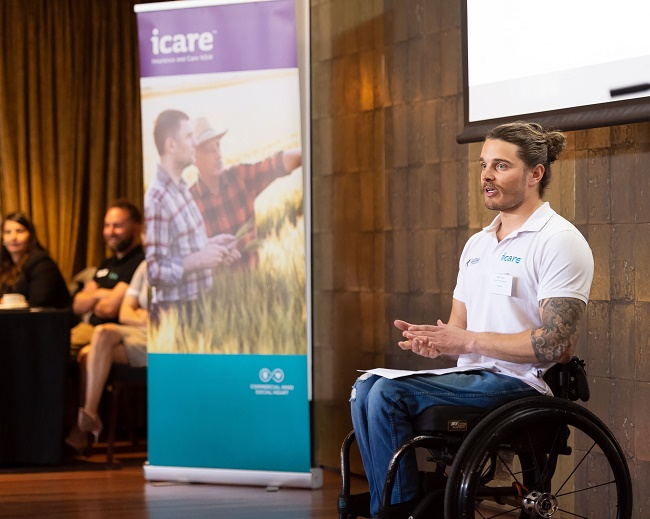 Image of Paralympian speaker, Sam, during a presentation.