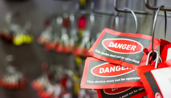Danger tags hanging on a wall in a factory