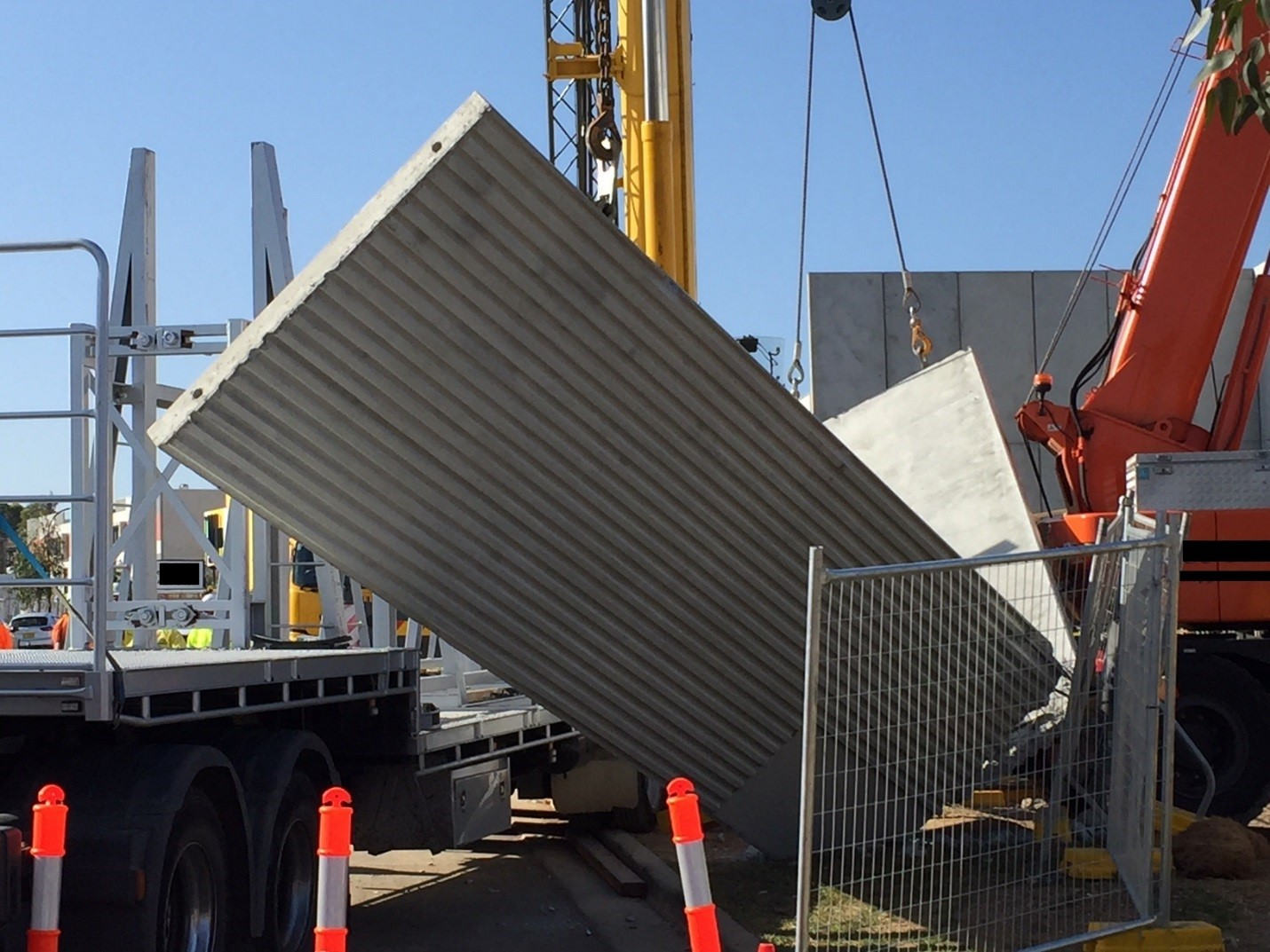 The pre-fabricated concrete panel which broke into pieces when being raised into place.