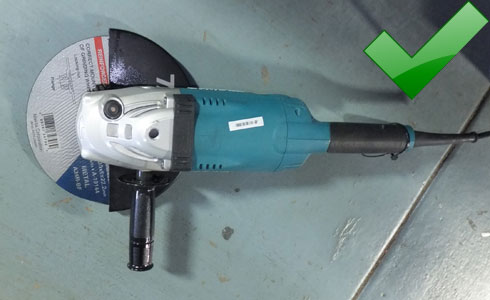 230 mm (9 inch) angle grinder with guard and right sized disc fitted.