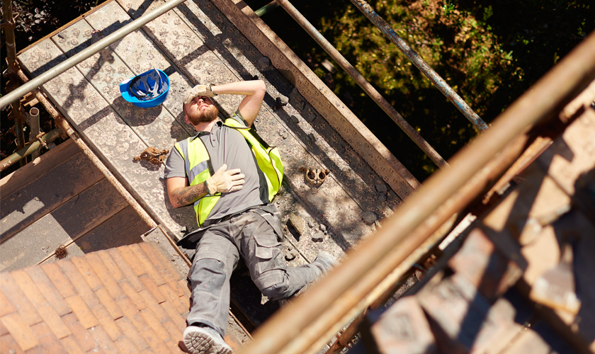 Man lying down on construction site