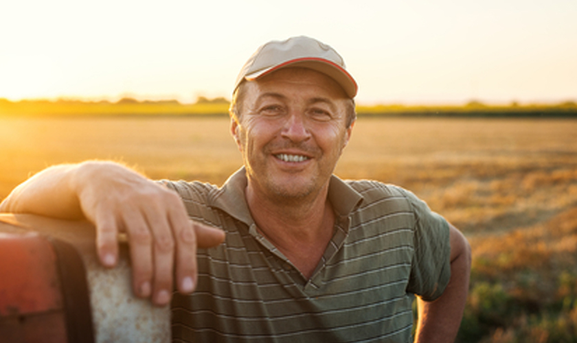 Man smiling in field of grass