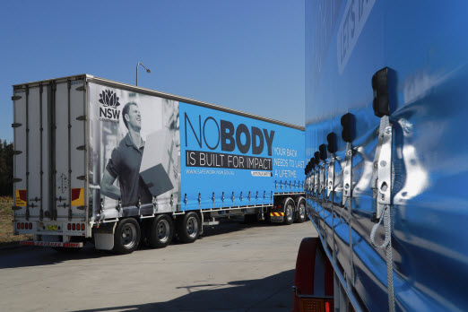 Two truck trailers with advertising