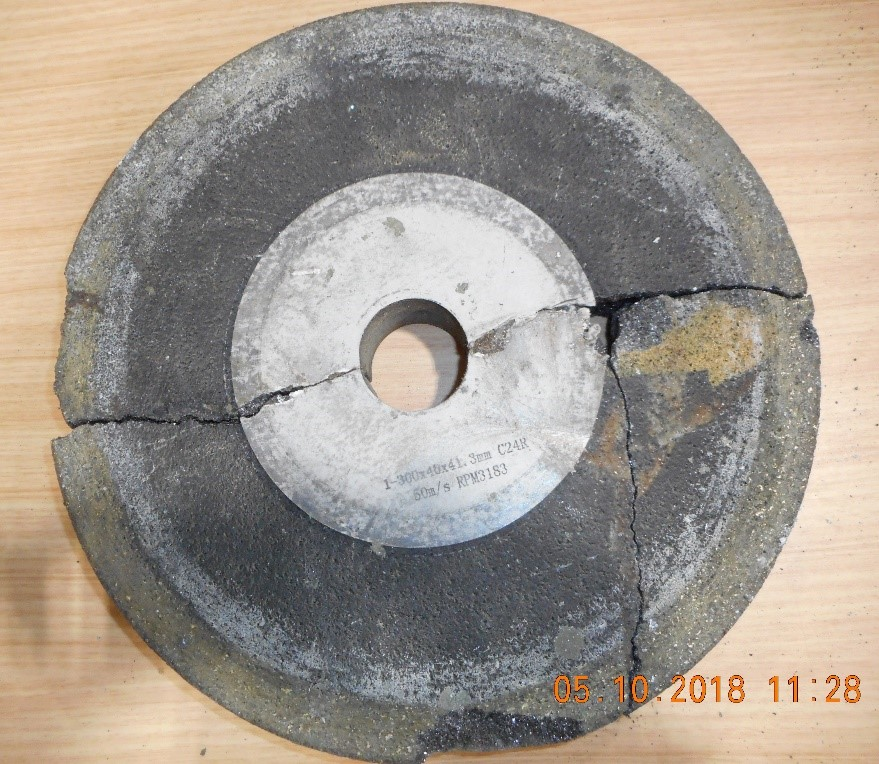 Figure 1 shows an example of a bonded abrasive wheel (300mm diameter) which broke apart during operation, resulting in fatal injuries to the operator.