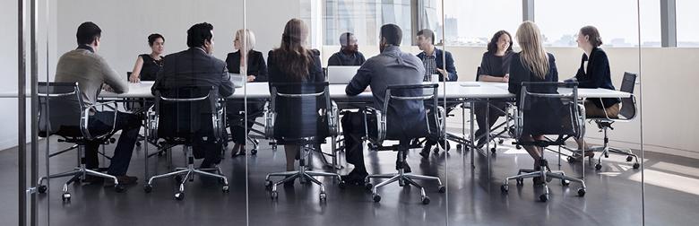 office workers in meeting room