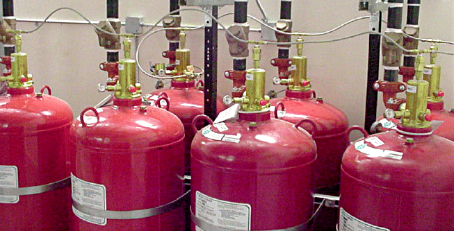 Gas cylinders forming part of a fire suppression system