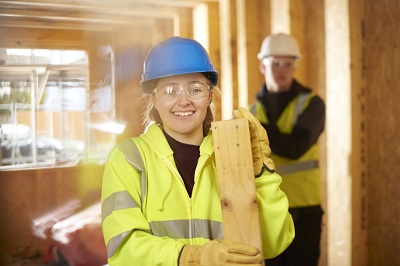 Photo of a young female construction worker.